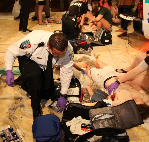 Paramedic helping man in trauma event | 911 e-Learning Solutions LLC